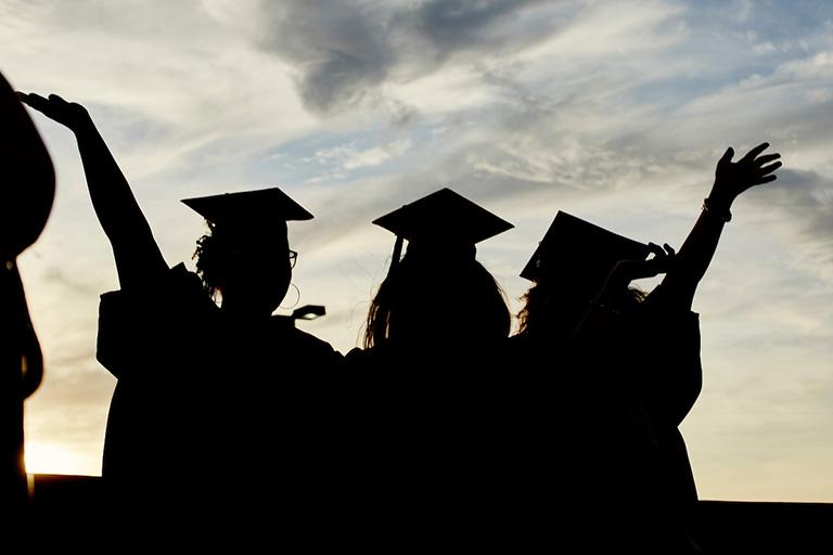 silhouette of graduates