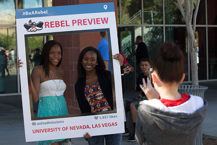Students posing for a photograph during Rebel Preview event.