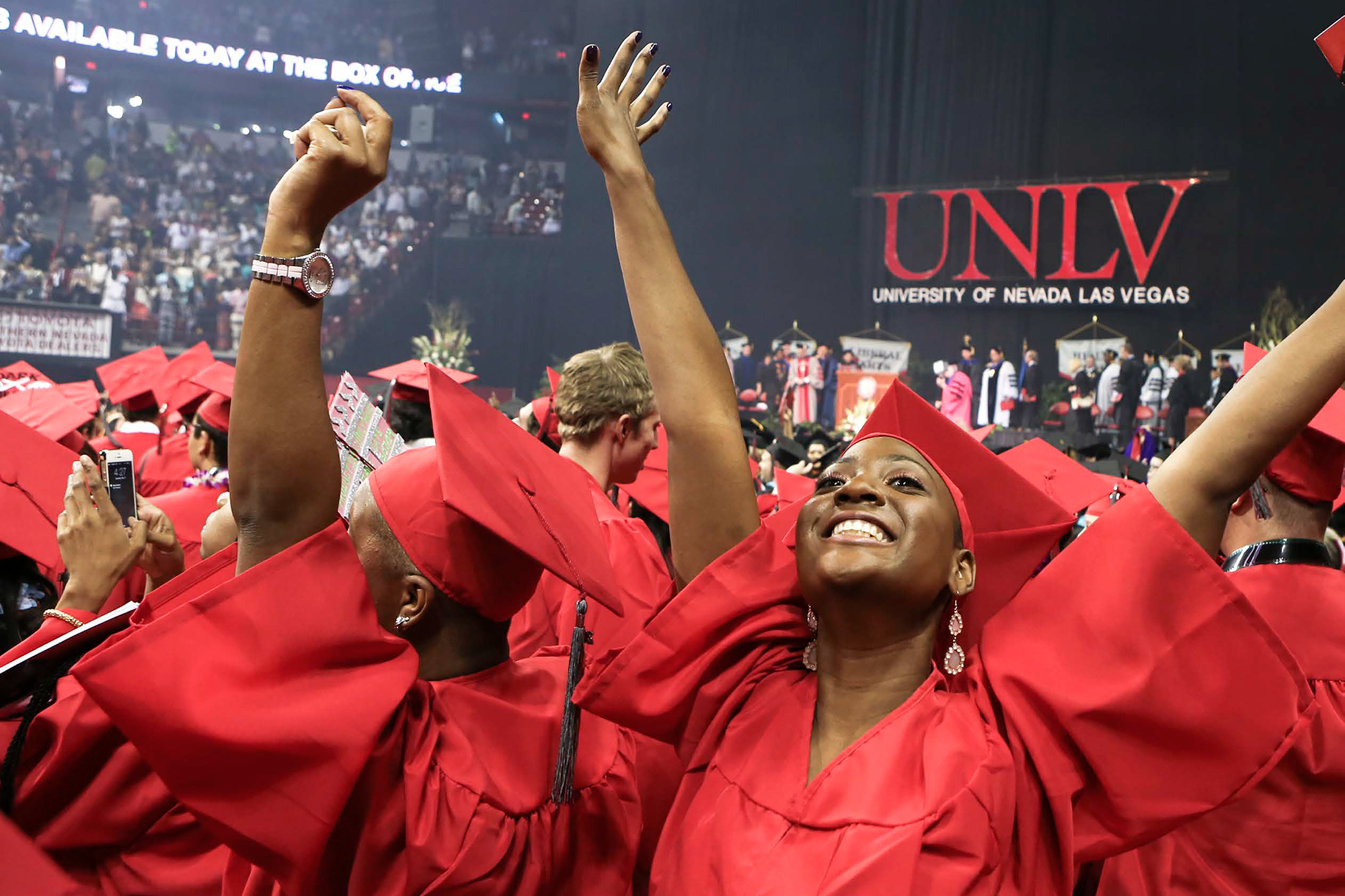 University Of Nevada Las Vegas Taco Wiring Diagrams Zone Boards Female Graduate Raises Her Hands Up In Celebration During Commencement