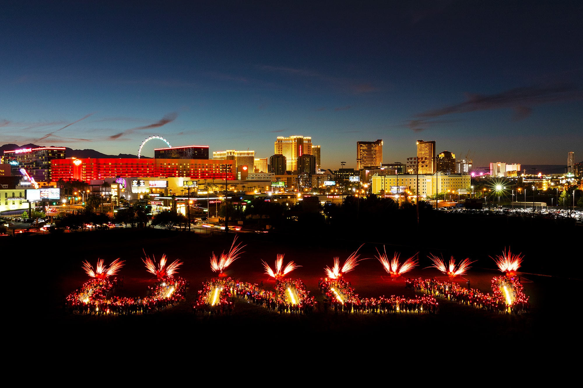 U.N.L.V. letter formation and fireworks display with the Las Vegas strip in the background