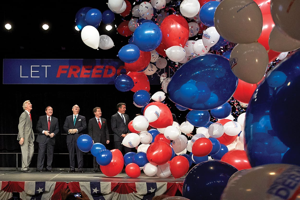 balloons fall from the ceiling at the debate announcement press conference