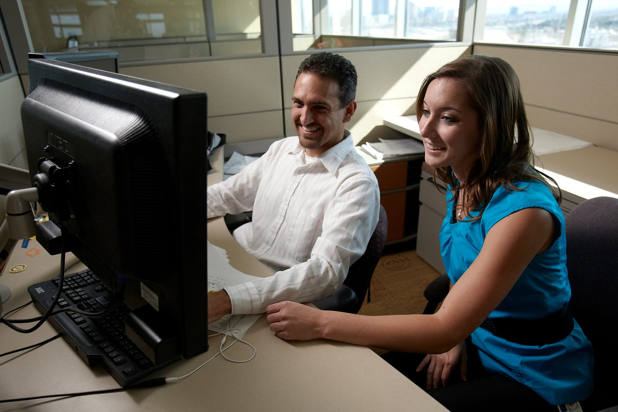 Two people working at computers