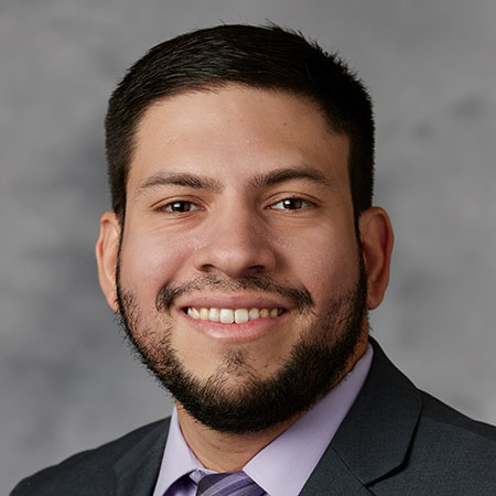 Headshot of Carlos A. Flores, Ph.D