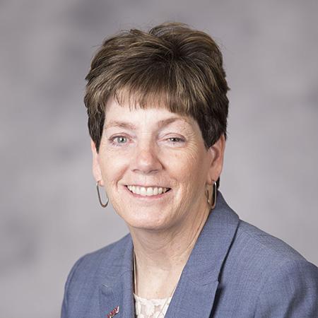Headshot of Maggie Farrell, M.L.S.