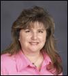 Headshot of Gina Agrellas
