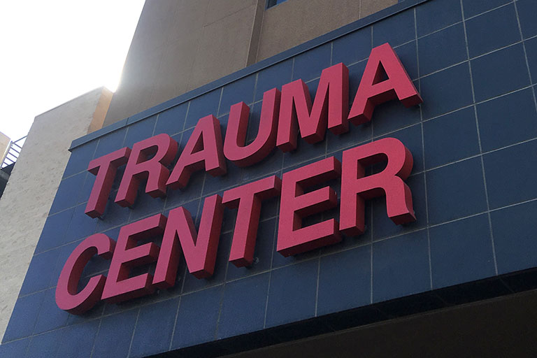 Red Trauma Center signage outside of U-M-C Hospital.