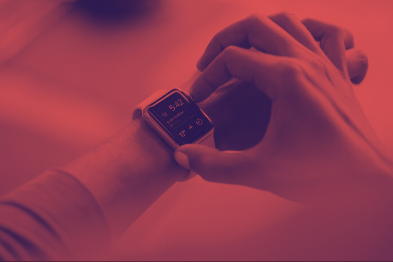 Red image of person using apple watch