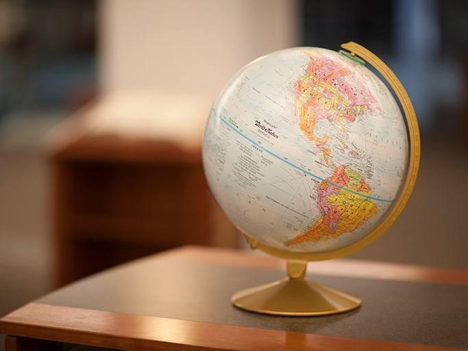 World globe resting on an office desk