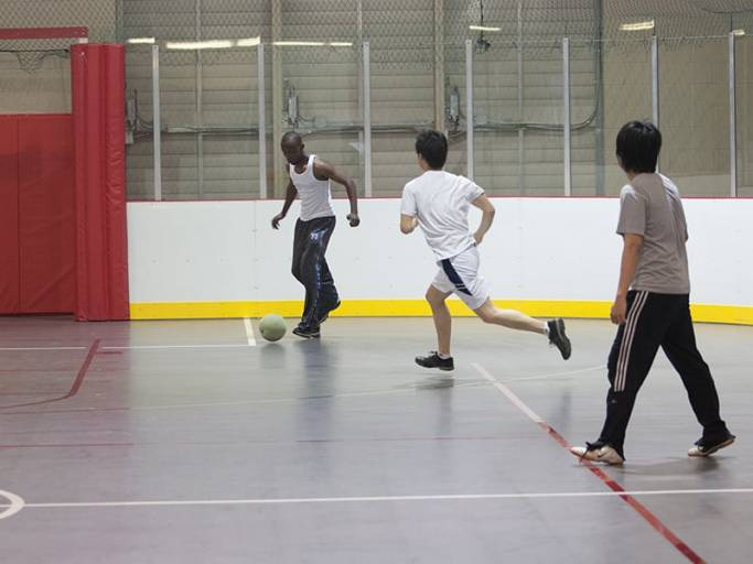 Students playing indoor soccer at an court in the SRWC.