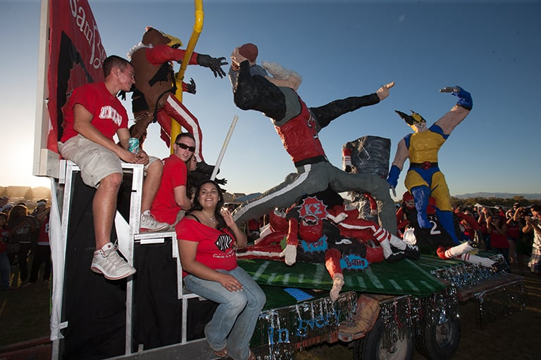 Students on a homecoming float.