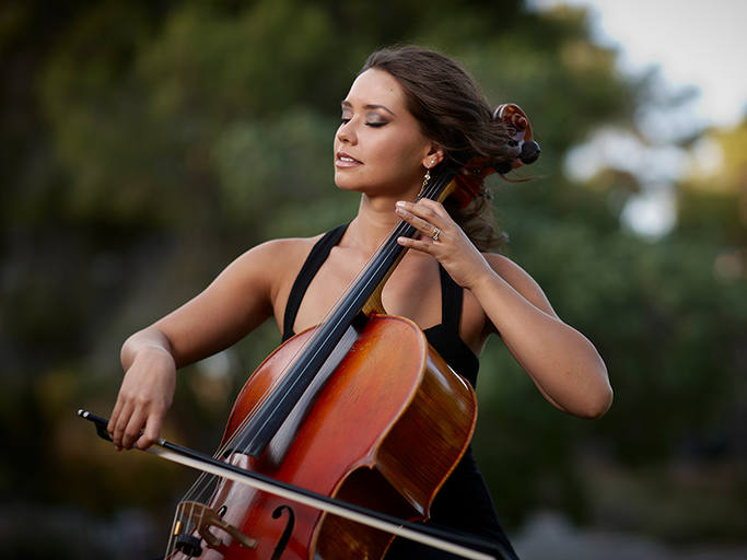 A woman playing a cello