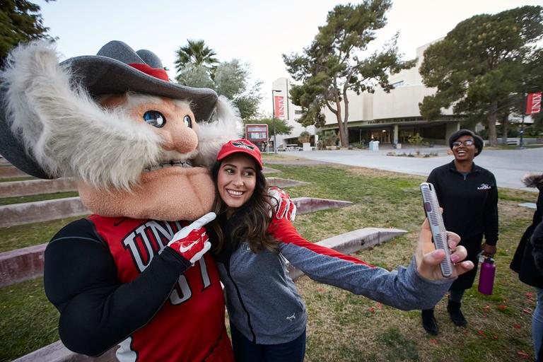 Hey Reb! posing with student for a selfie