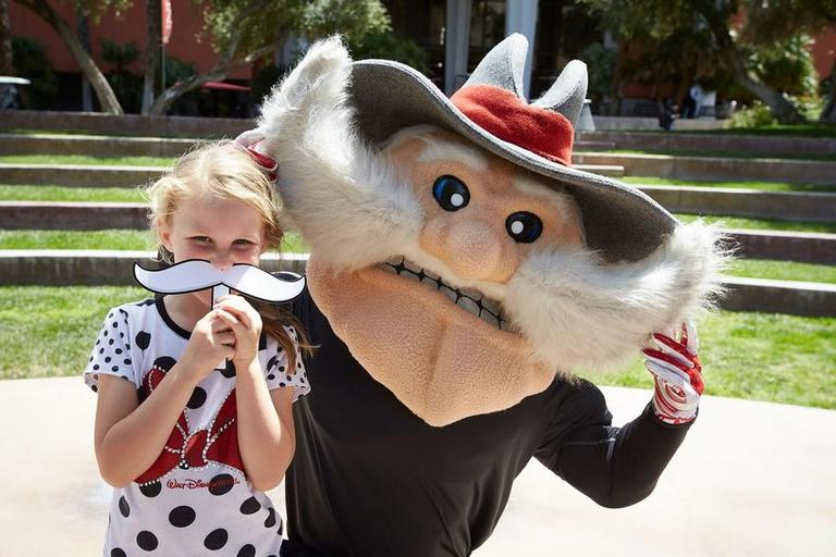 Young girl poses with Hey Reb!