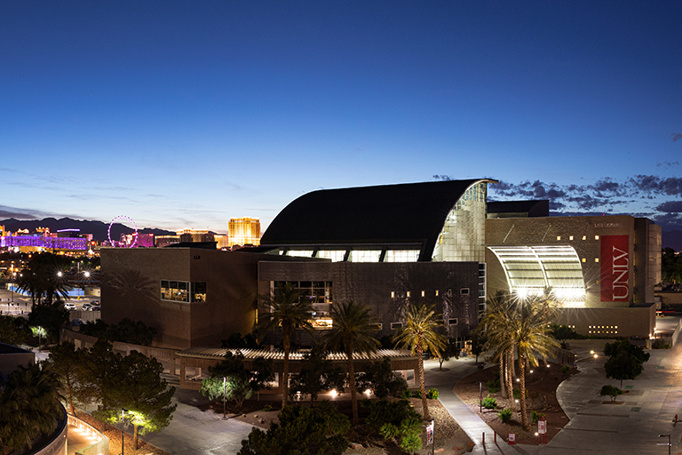 Lied Library in the evening with the Las Vegas Strip glowing in the background.