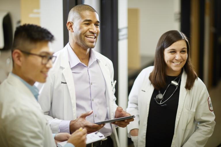 People standing in white doctor coats