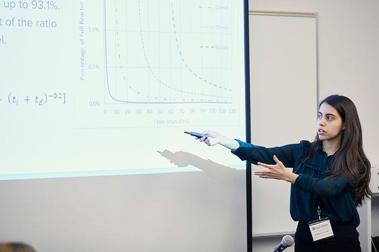 A professor explaining a graph to the class