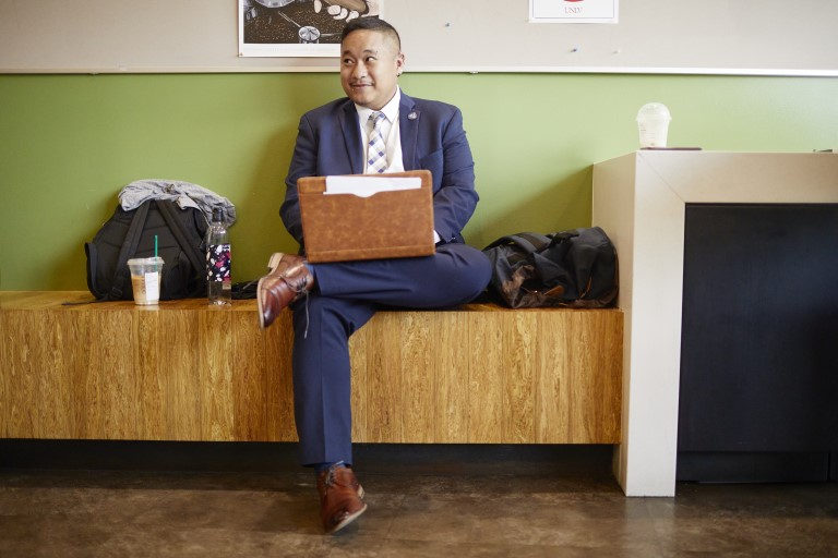 Man in a suit sitting with laptop