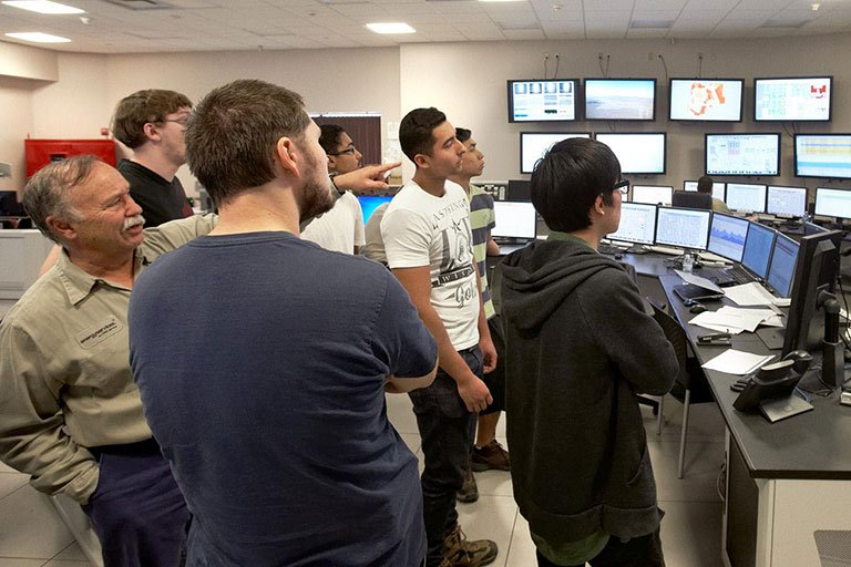 Students looking at a computer.