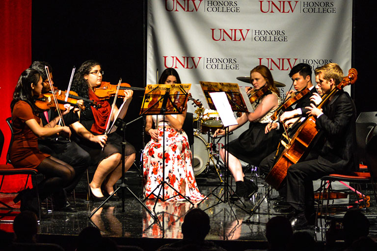 Multiple students playing the violin