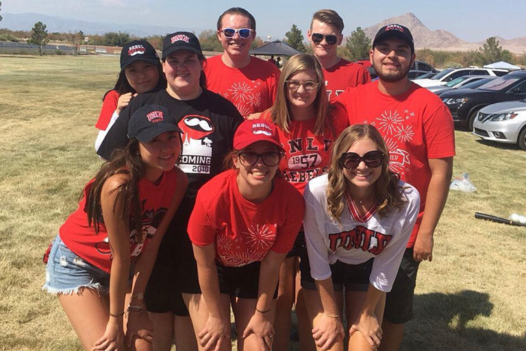 Students attend a tailgate