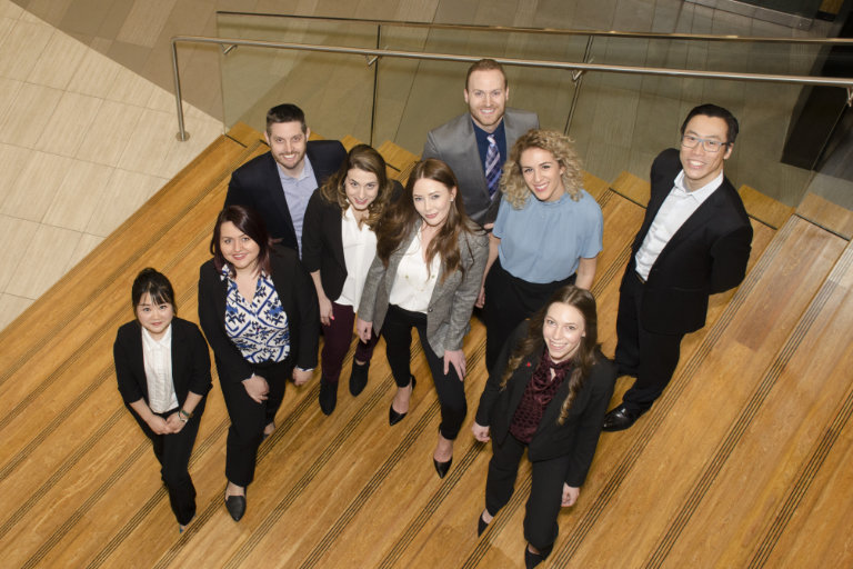 Group of MBA students take a photo at a staircase