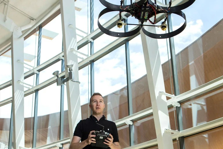 A man flying a drone