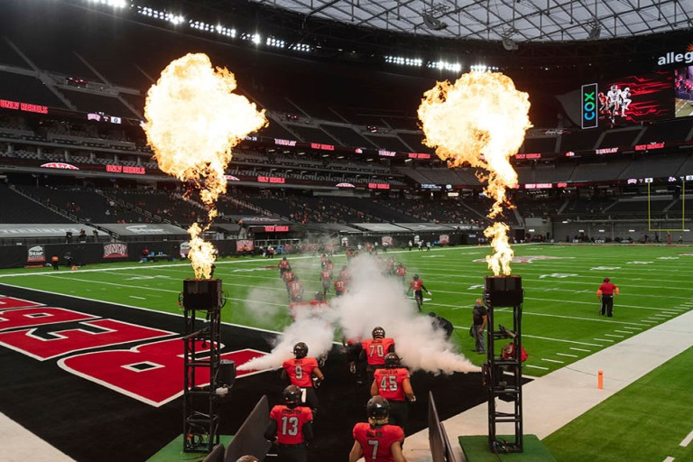 UNLV Team entering the field with pyrotechnics