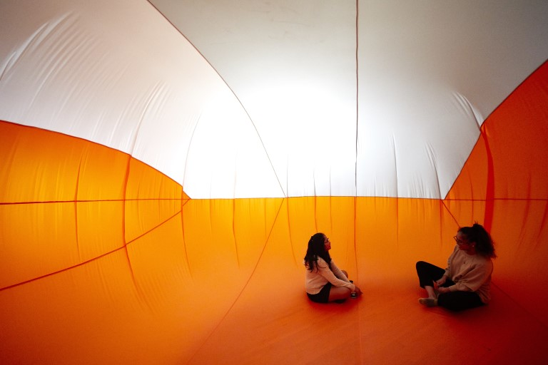 Two people inside an inflatable room