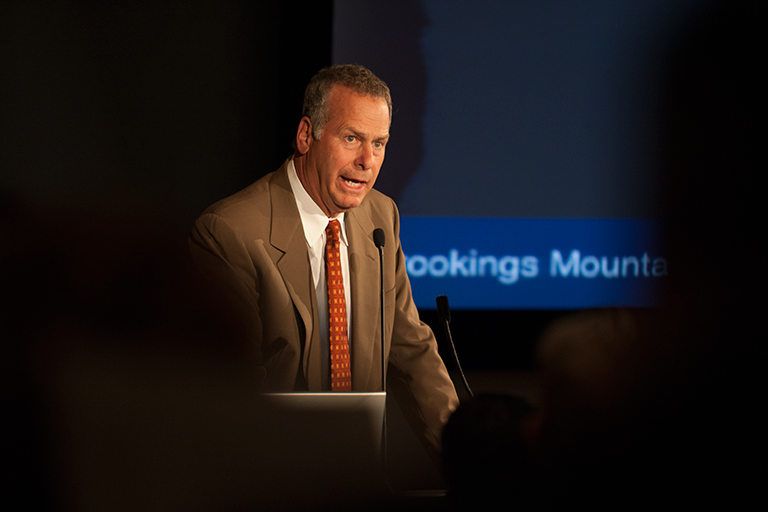 Speaker at the podium during a Brookings Mountain West presentation.