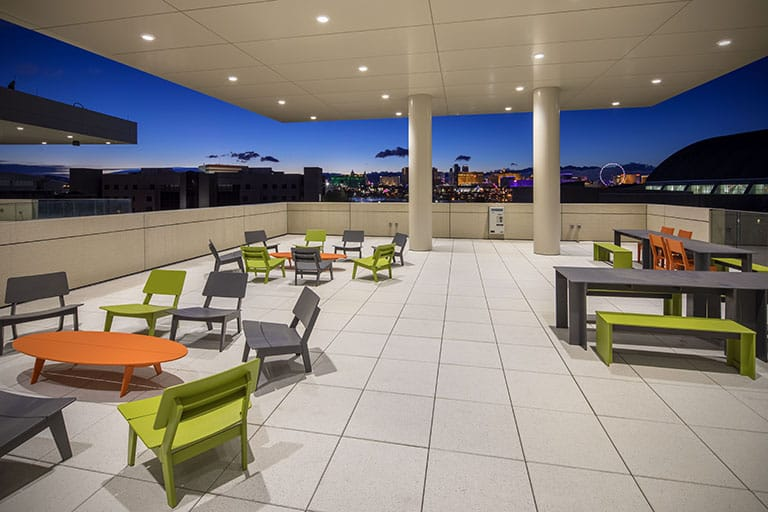 Outdoor terrace with various multi-colored tables and chairs