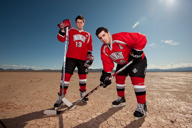 Two UNLV hockey players in the desert