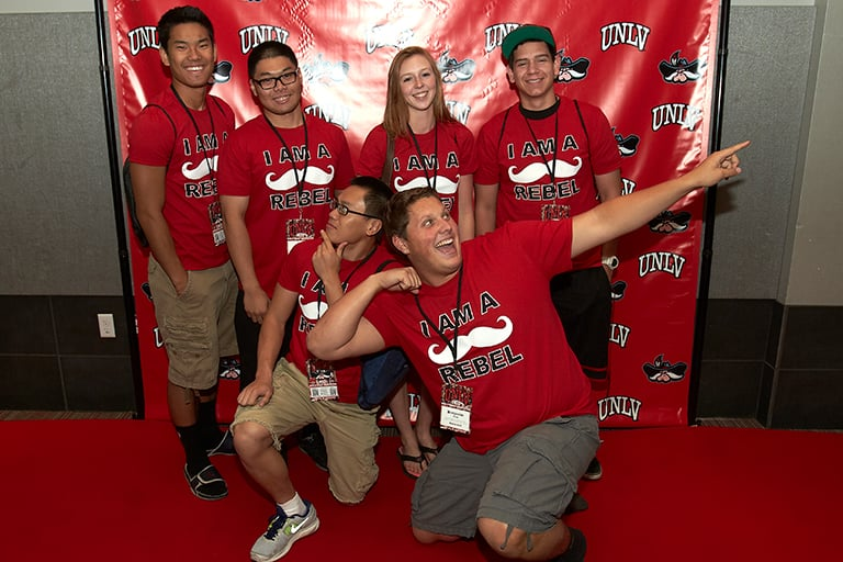 New Students posing in front of UNLV student union.