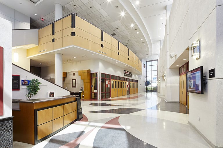 Lobby of the Stan Fulton Building, a large, open, white space with paths leading to different areas of the building