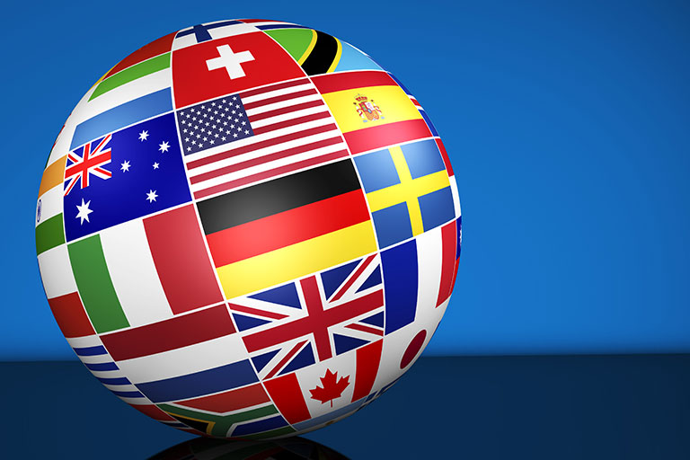 Photo of globe with flags