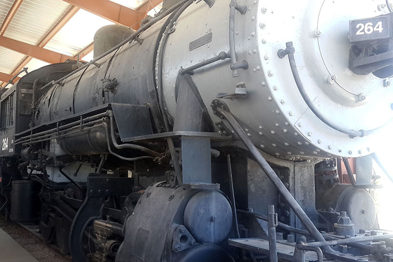 Black train inside a station.