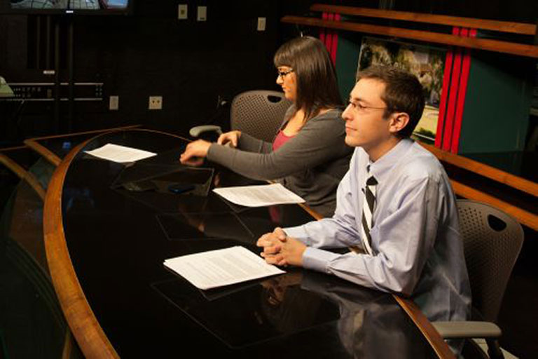 Students working at an anchor desk.