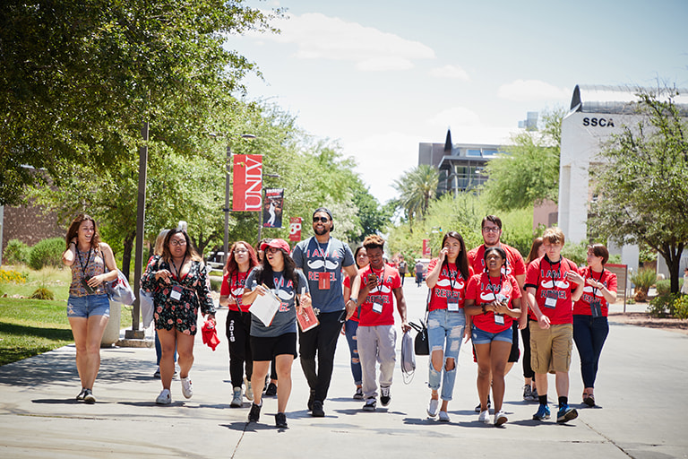 A diverse group of students walking on campus.