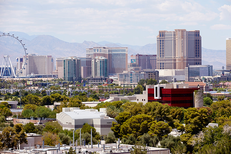 An aerial view of U.N.L.V. campus and the Las Vegas strip in the background.