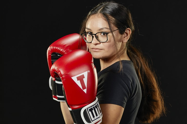 Woman posing with boxing gloves