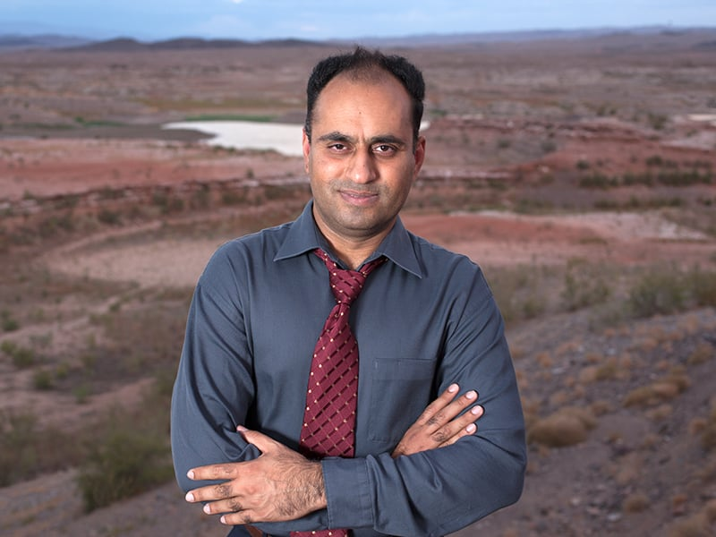 Professor Ahmad with Lake Mead in the background at a very low water level.