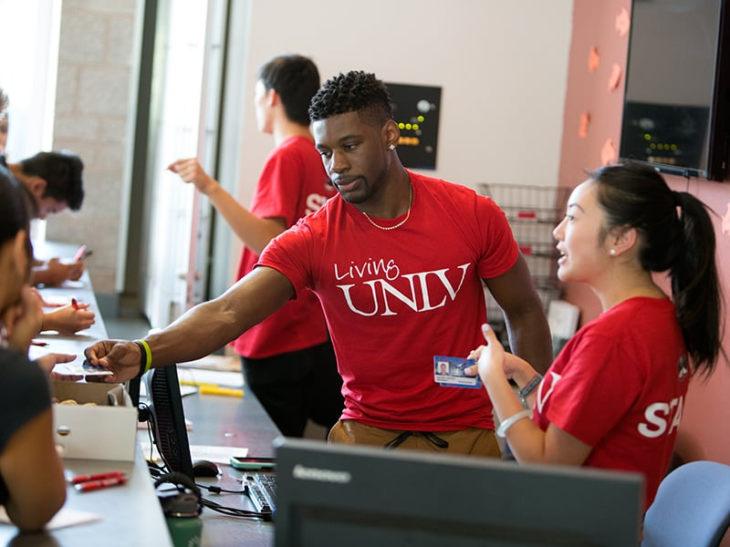 Students working at the front desk of Student Union.