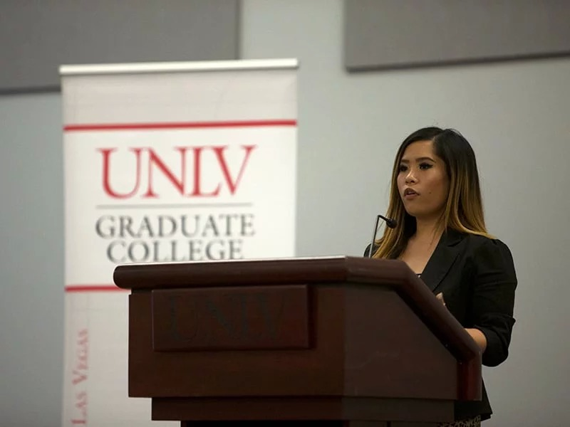 A student speaking at a podium