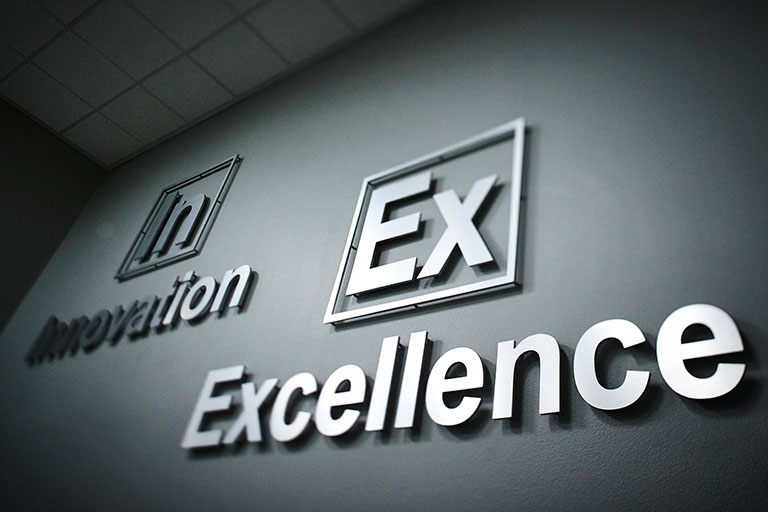 Innovation and Excellence graphic on a wall