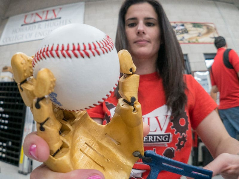 Maria Gerardi works on a 3D-printed prosthetic hand.