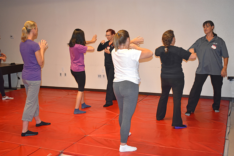 Women participating in a self defense training course
