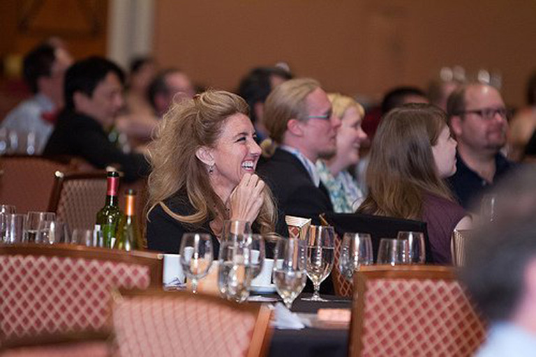"alt=""Woman Smiling at Dr. Eadington Celebration Dinner"""