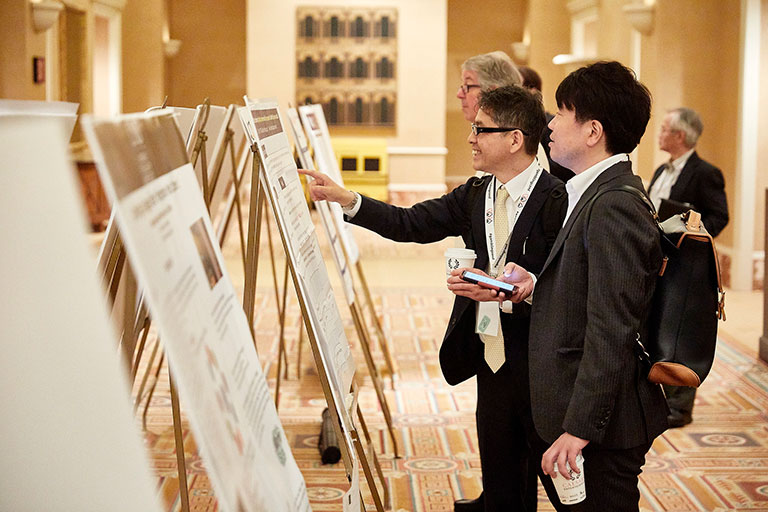 Attendees looking at different posters