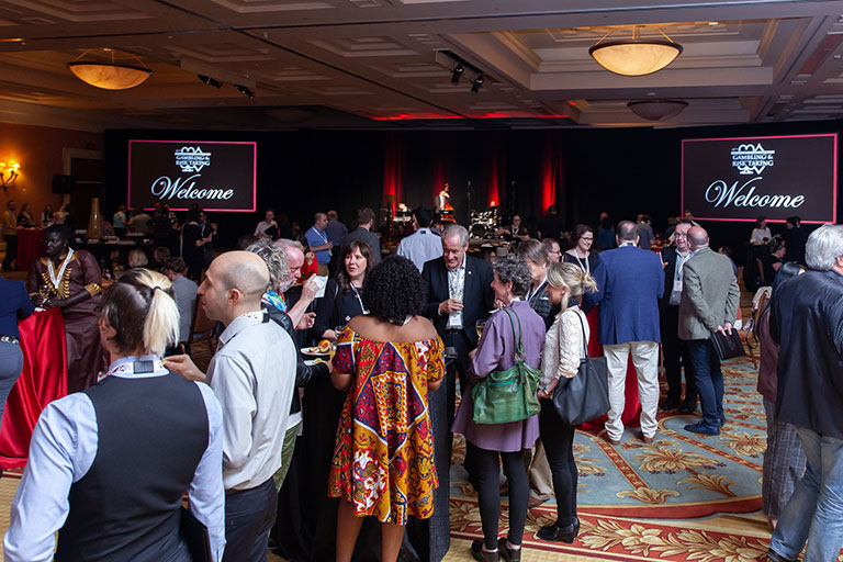 Many attendees enjoying the conference's opening reception