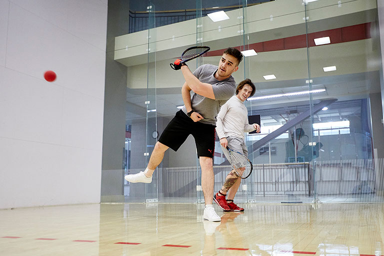 Group of people playing Squash