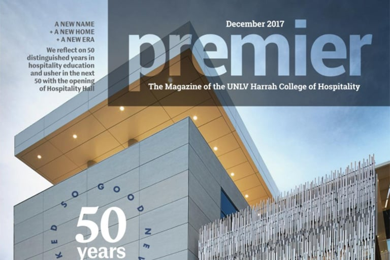 "alt=""The cover of the Decemember 2017 edition of premier magazine, showing the new Hospitality Hall building completed."""